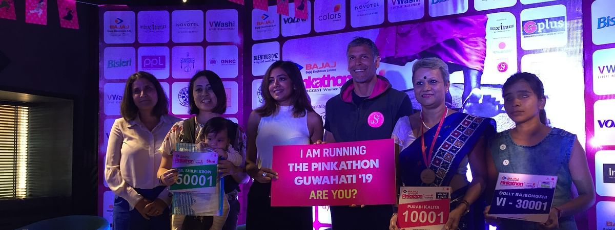 Supermodel-actor Milind Soman with mascots of Pinkathon Guwahati