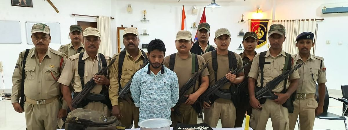 The arrested rebel of ULFA-I along with the seized items