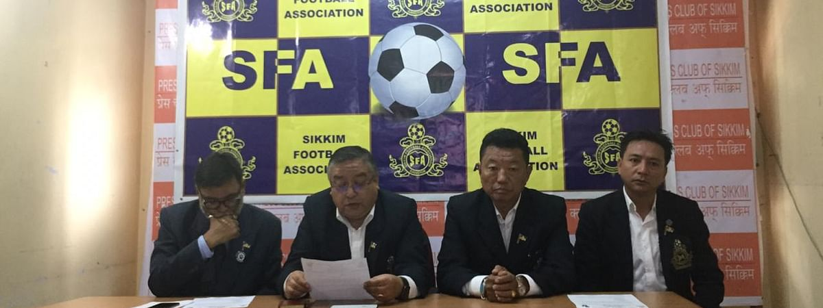 Sikkim Football Association president Menla Ethenpa and other officials addressing a press meet on the upcoming football tournament in Gangtok