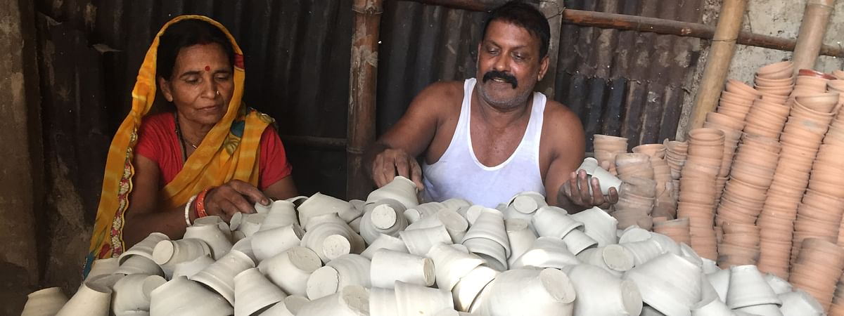Srikant Prasad along with his wife making clay cups at his small pottery unit in Amingaon near Guwahati in Assam