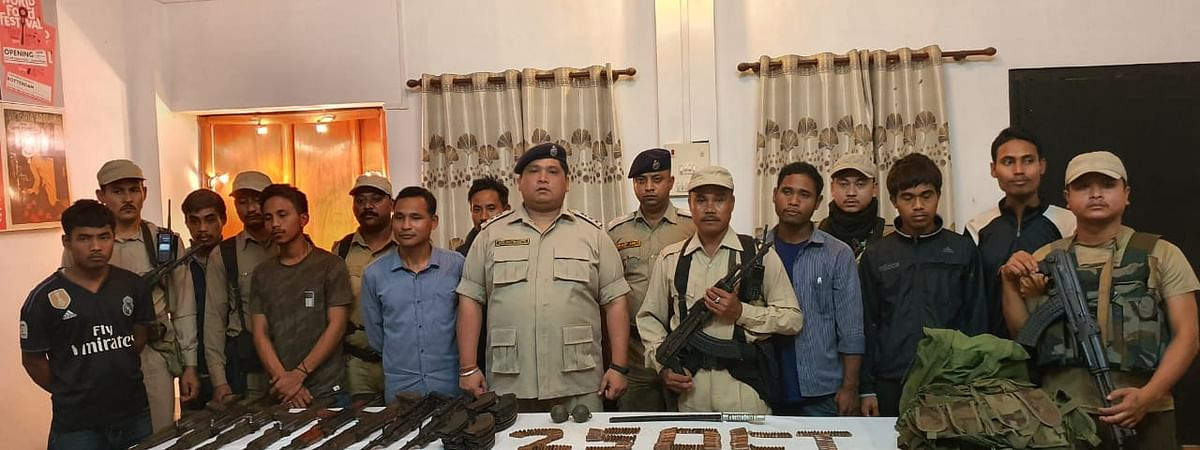 Security personnel with the surrendered ULFA-I rebels in Tinsukia