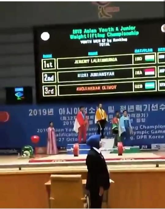 Jeremy Lalrinnunga at the victory podium in Pyongyang, North Korea