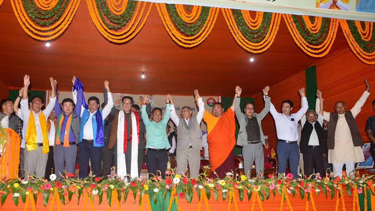 Union minister of state for youth affairs and sports Kiren Rijiju with Sikkim CM PS Golay and his team of ministers and BJP candidates ahead of by-elections in the state