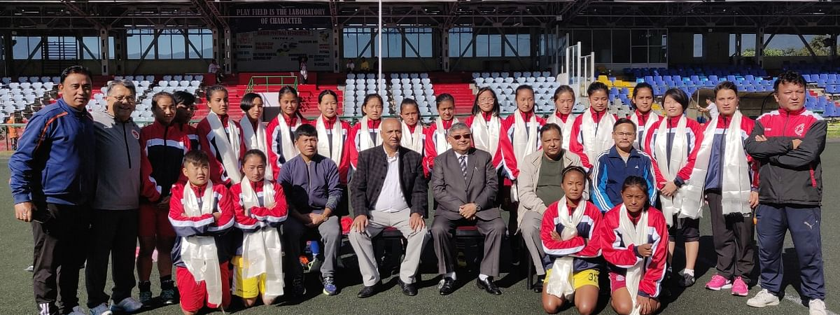 Sports minister KN Lepcha with the state team and officials at Paljor Stadium in Gangtok