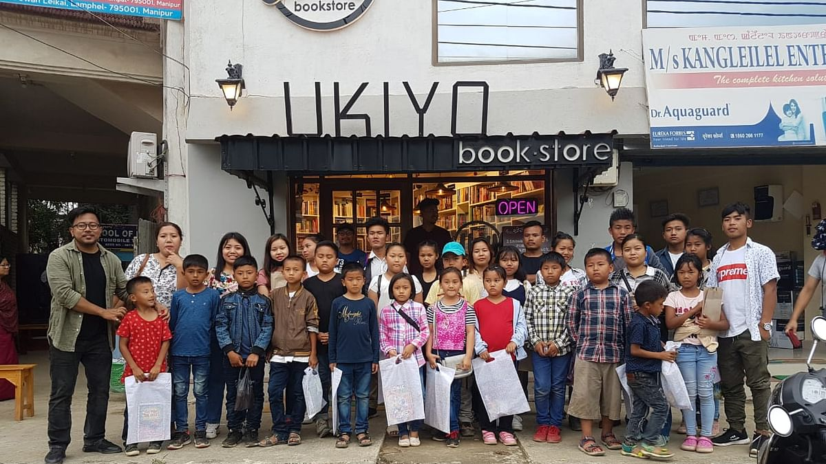 Martin Thokchom (first from left) with some school children and teachers from a far-flung hill district in Manipur outside his bookstore Ukiyo