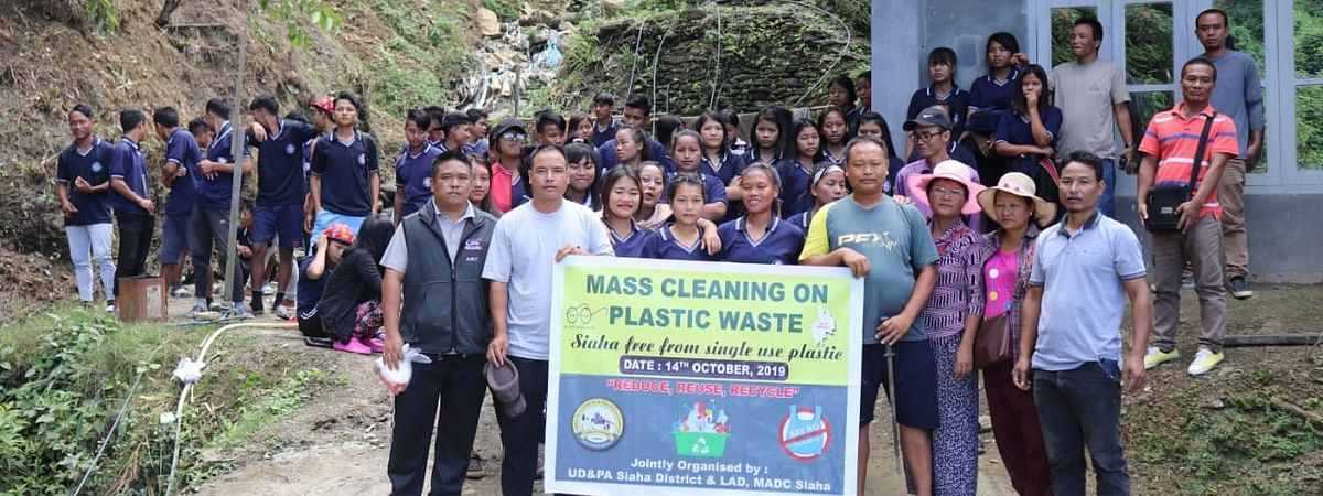 Siaha Town Sanitation Task Force members taking part in the cleanliness drive in Mizoram's Siaha town on Monday