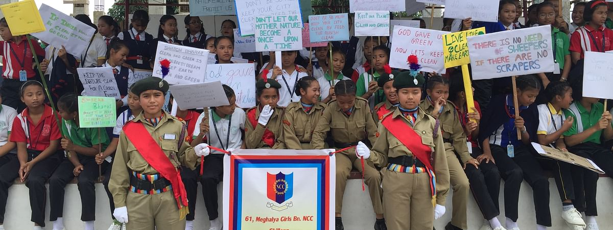 Students of St Joseph's Girls Higher Secondary School Jaiaw holding placards on save mother earth