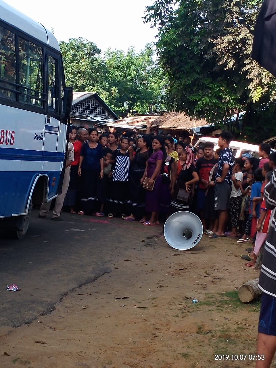 Bru women blocking the convoy of vehicles in North Tripura on Monday