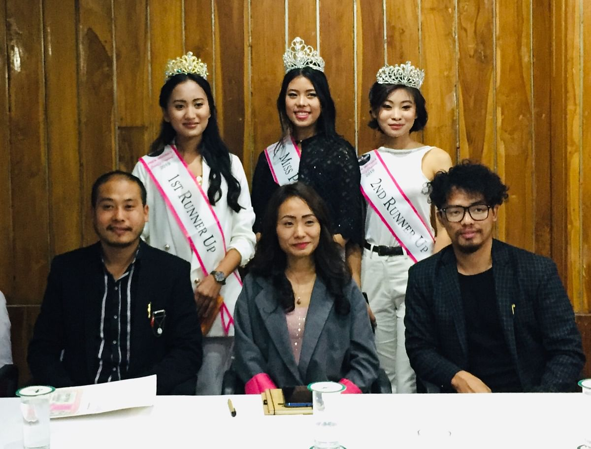 (Front row, seated) Vogue Entertainment Nagaland convenor Dode Nakro (left), general secretary Diwe-u Thele (middle) and co-convenor and official designer Vilhousa Movi along with the winners of Miss Phek 2019 during the press conference held at Hotel Japfü in Kohima on Tuesday evening