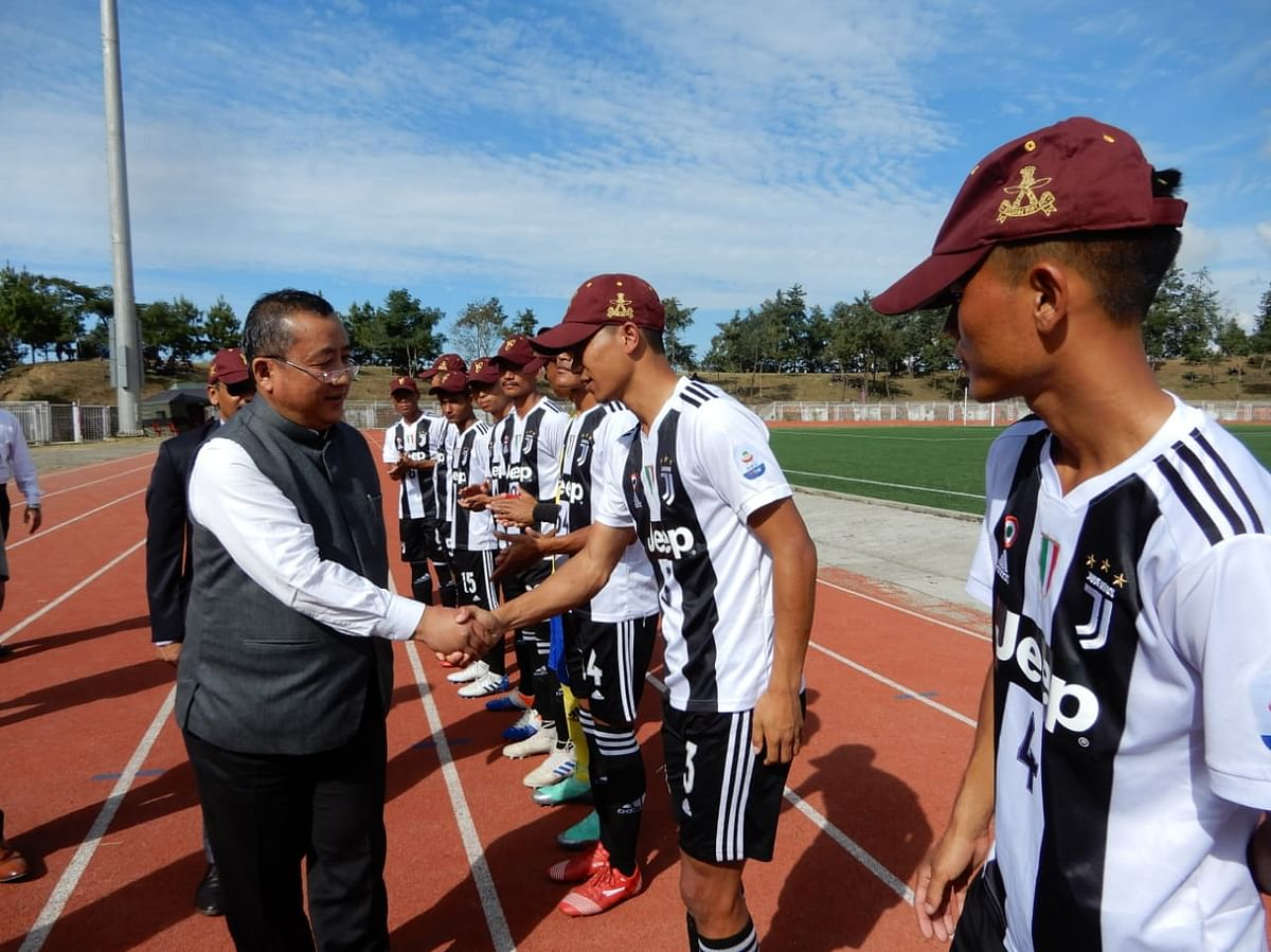 Chief secretary Temjen Toy along with the players at IG Stadium in Kohima on Friday