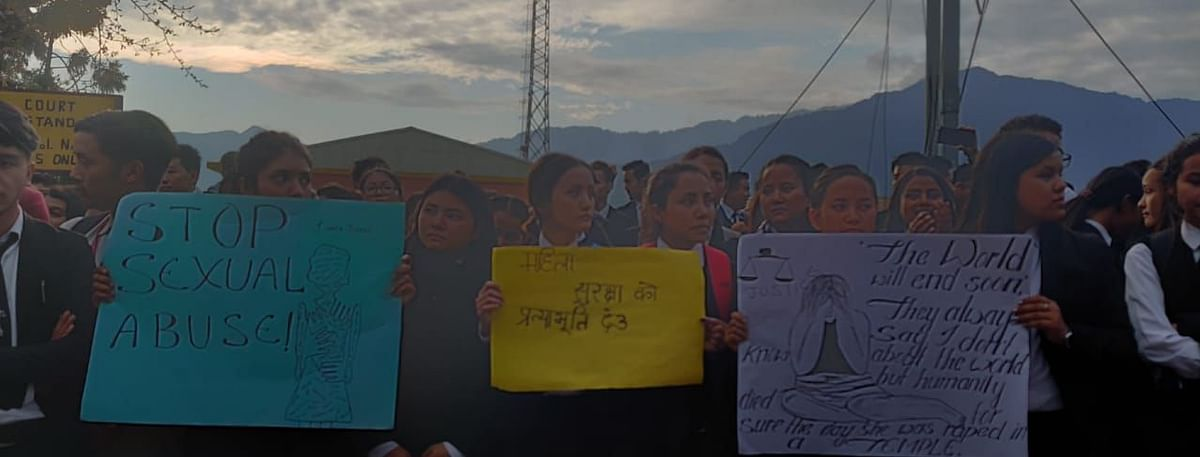 Students holding placards against 'sexual abuse' during the peaceful march on Wednesday