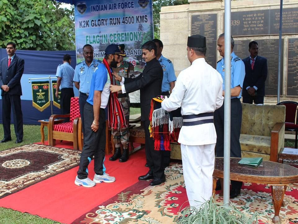 Nagaland governor RN Ravi felicitating the runners with Naga traditional stoles