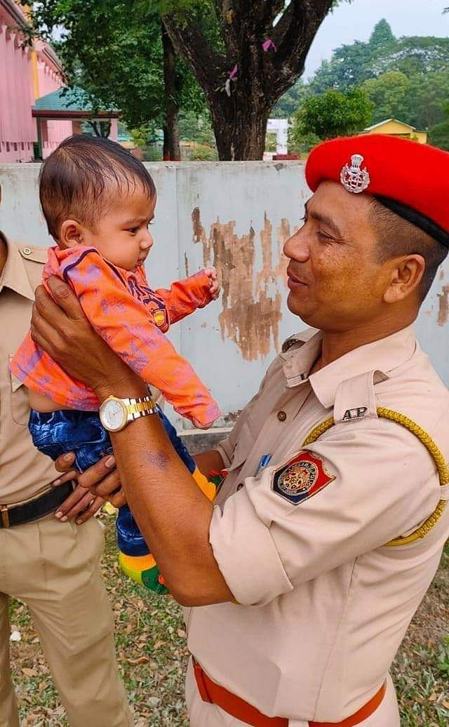 This picture, uploaded by a Twitter user @amanhussain, is from Darrang where a policeman on duty was seen holding a baby while the mother took her exam on Sunday