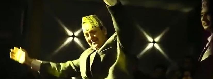 Former Nepal King Gyanendra Shah waving to the crowd at a nightclub in Nepal