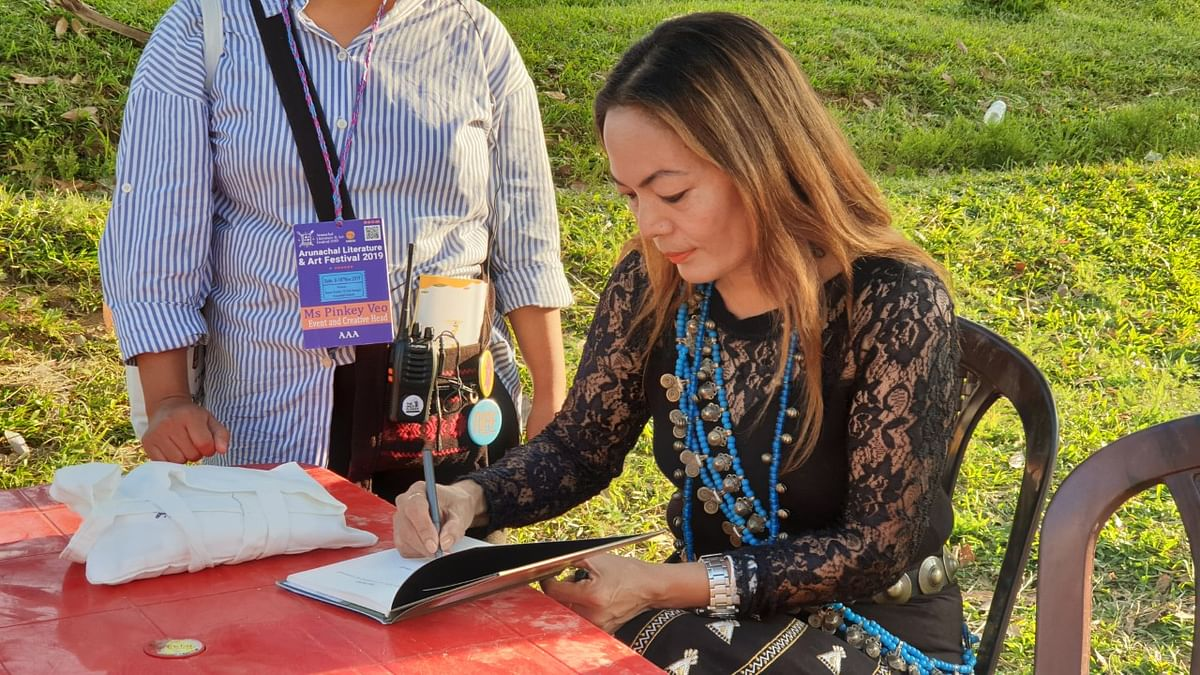 Tumbom Riba 'Lily' signing her book for the readers at the second edition of the Arunachal Literature & Art Festival