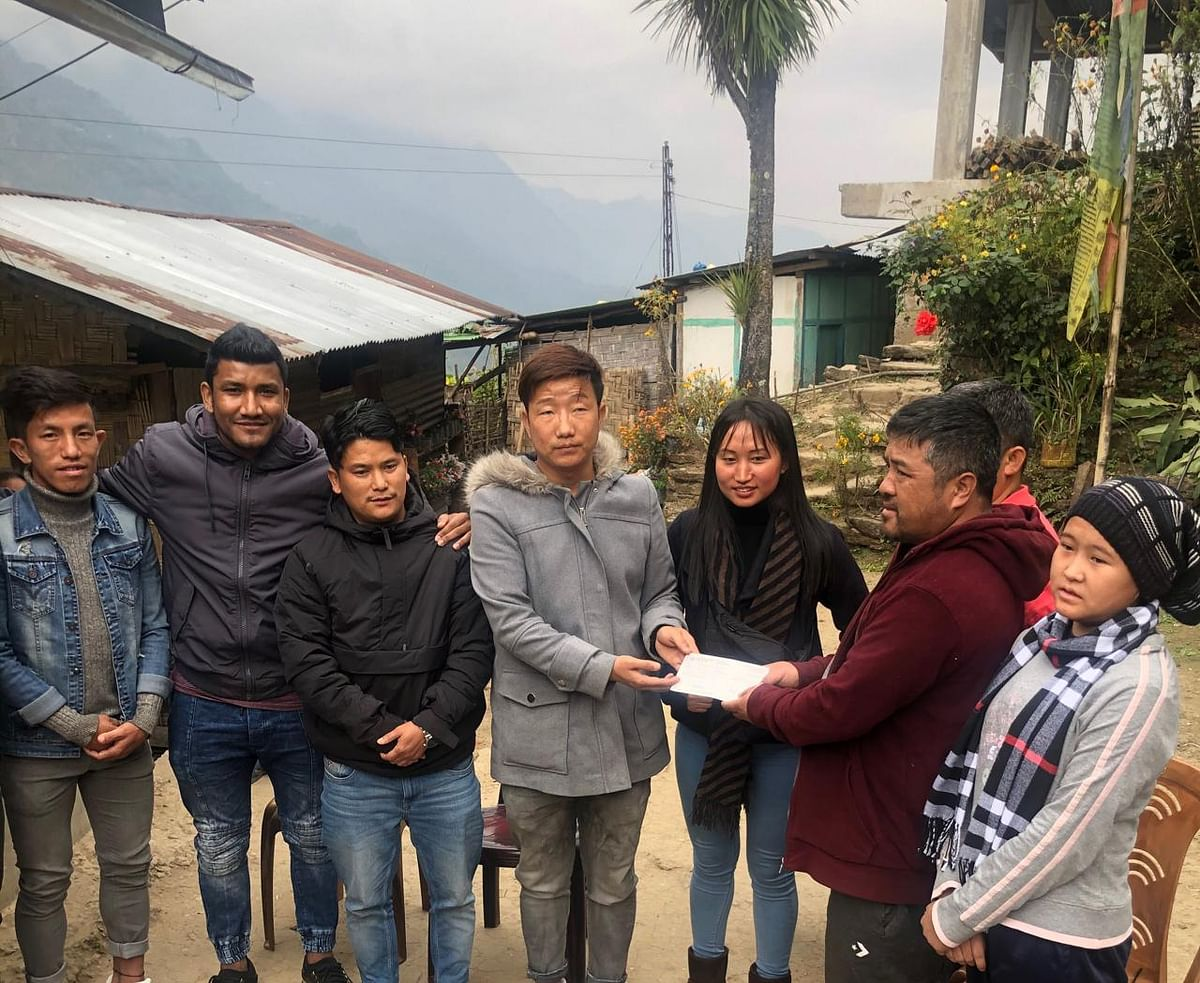A delegation of the Football Players' Association of Sikkim handing over the cheque of Rs 4 lakh to the parents of footballer Reeya Lepcha (extreme right)