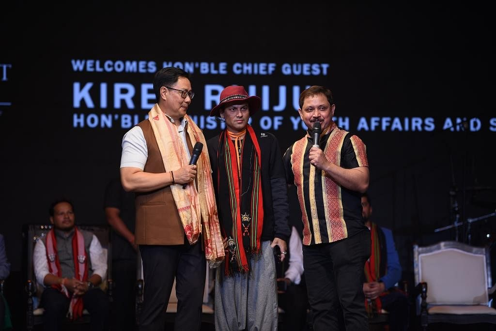 (From left) Union MoS for youth affairs and sports Kiren Rijiju, singer Zubeen Garg and organiser Shyamkanu Mahanta on the opening day of Northeast Festival in New Delhi on Friday