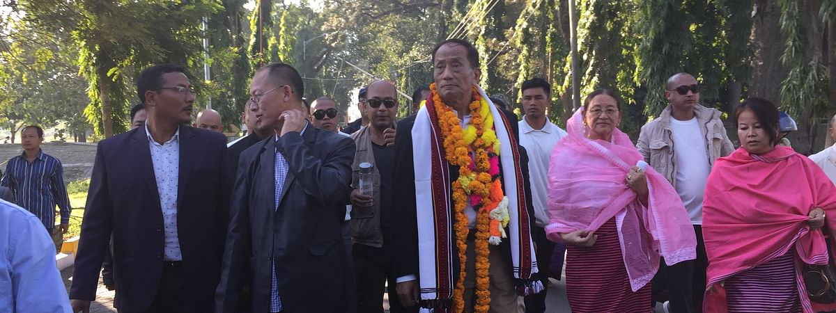 UNLF chief Rajkumar Meghen, accompanied by his wife and son, entering Kangla Fort soon after his arrival in Imphal on Thursday