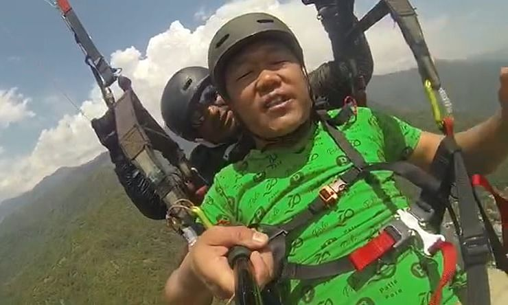 Darjeeling native Pawan (in green T-shirt) was gripped by acrophobia while enjoying a paragliding experience in Dharamshala, Himachal Pradesh recently