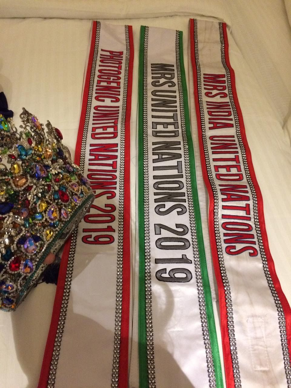 The sashes and the tiara bagged by Jessica Snock AK at Mrs United Nations 2019