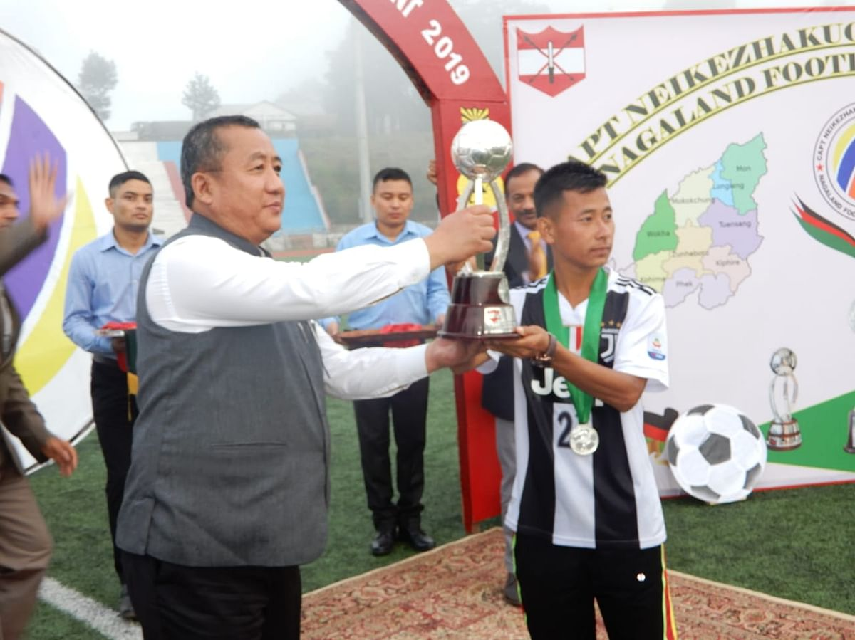 Chief scretary Temjen Toy awarding individual players for outstanding performance during the tournament