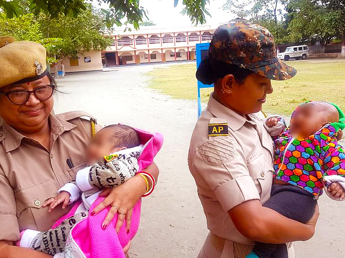 Assam cops cradle babies while mothers take exam, photos go viral