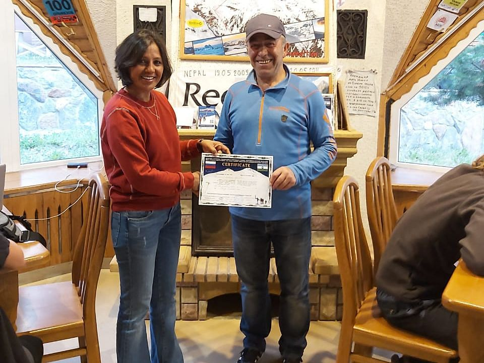 Dr Chetna Joshi receiving  climbing certificate from the Russian Mountaineering Foundation president
