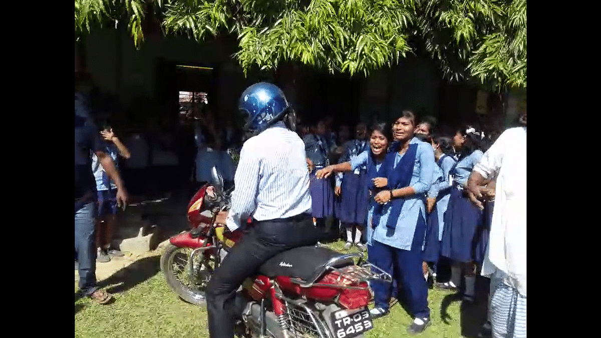 Students of Sataria High School cry as their one of the favourite teachers leaves school for the last time on Thursday