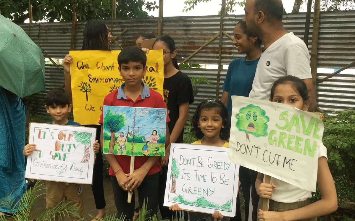 Children holding placards appealing government to protect trees and nature