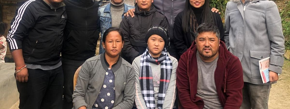 Reeya Lepcha (seated, middle) with her parents and a delegation from the Football Players' Association of Sikkim