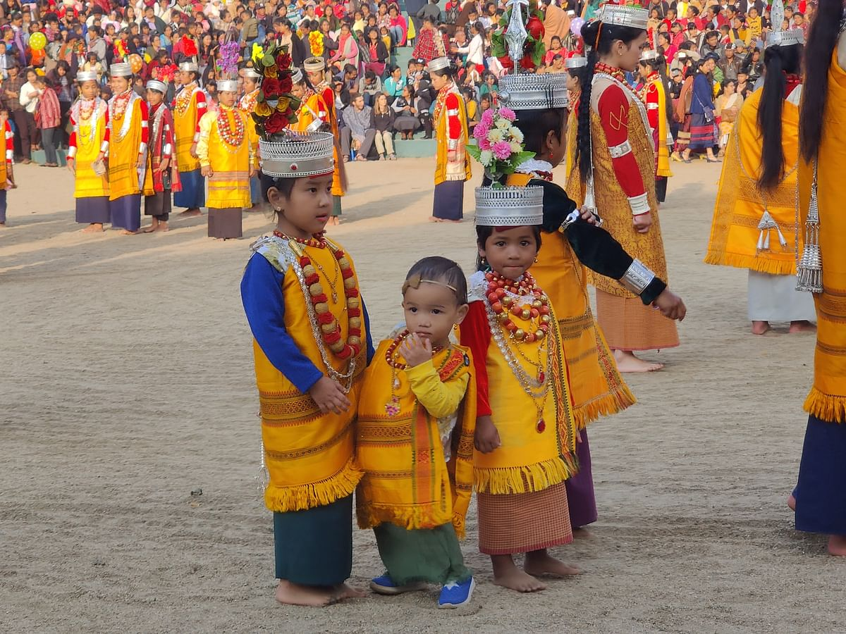 Children taking part in Nonkrem dance, decked up in traditional attire