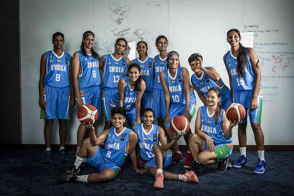 Nima Doma Bhutia (sitting, right) with the rest of the Indian women's basketball team