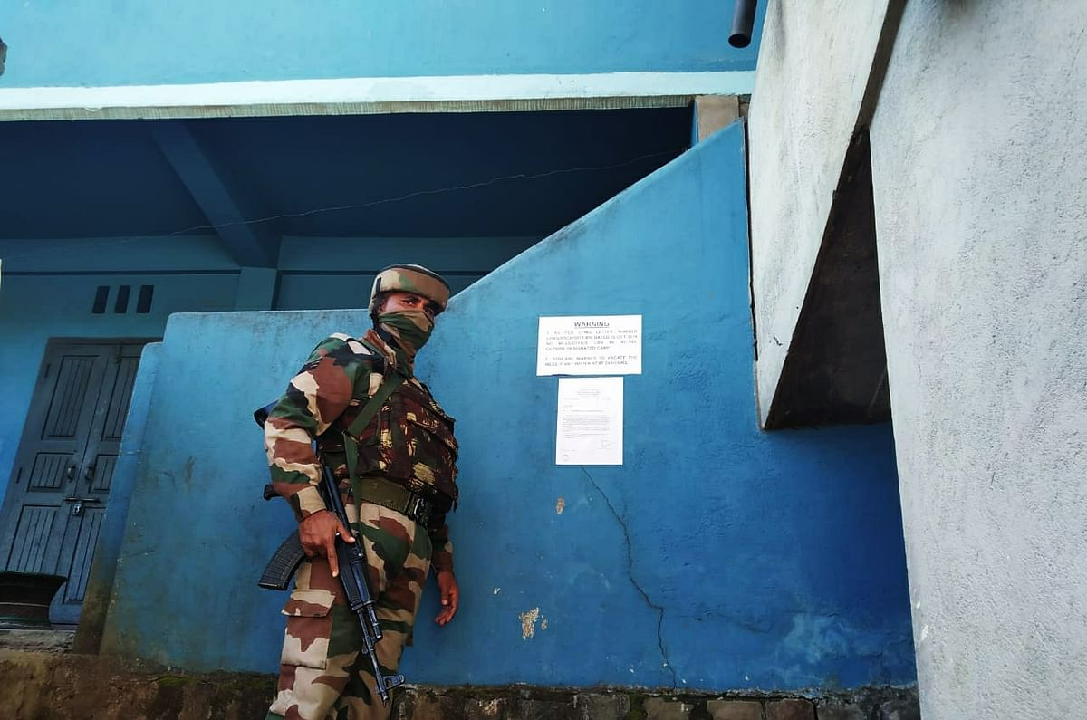 An Army jawan guarding a camp