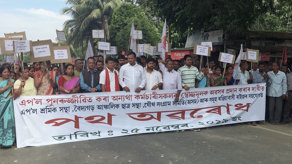 APOL employees organising a road blockade at Rangia in Assam's Kamrup rural district