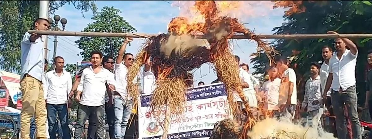 Protesters burn effigies during a rally in Tinsukia, Assam on Monday