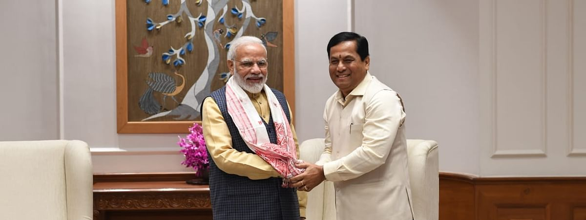 Assam CM Sarbananda Sonowal (right) greeting PM Narendra Modi in New Delhi