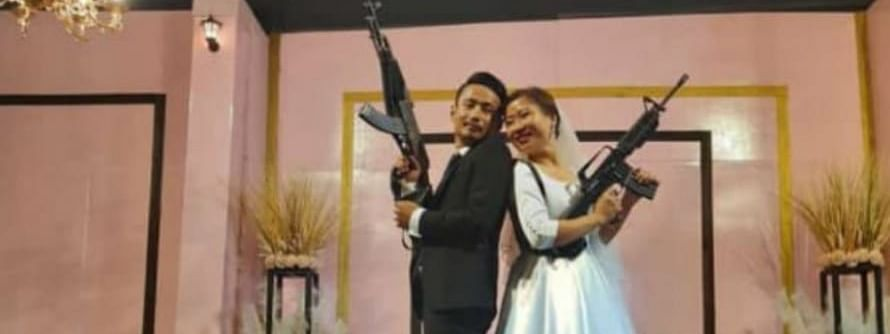 The newlywed couple brandishing assault rifles at their wedding reception in Dimapur, Nagaland