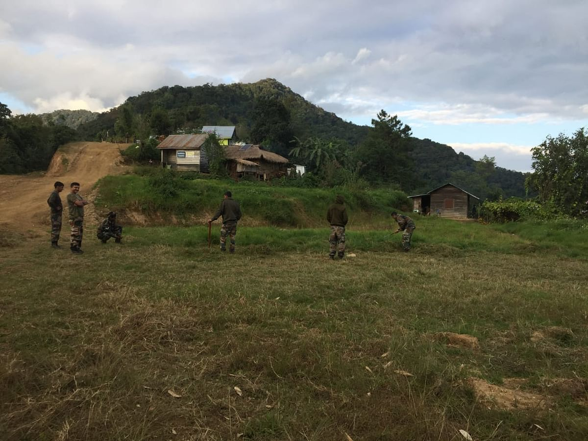 Troops at Sahamphung of Manipur's Kamjong district clearing an open space to make way for a volleyball court