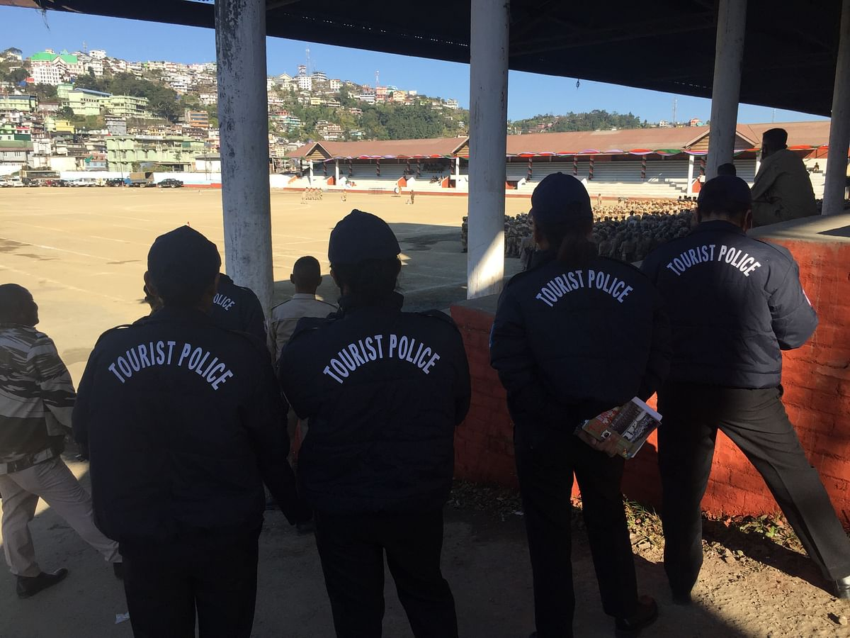 Tourist police watching the Nagaland police during a practice session for the 57th statehood day