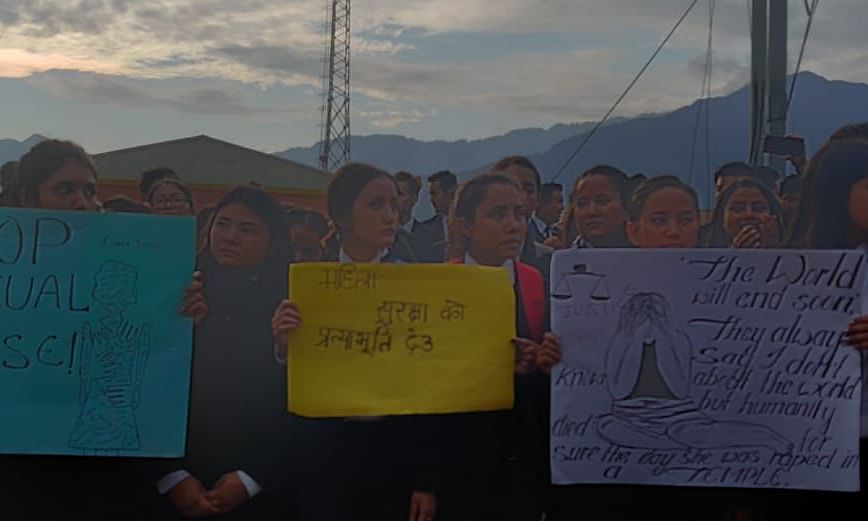 Students holding placards seeking justice for the deceased girl