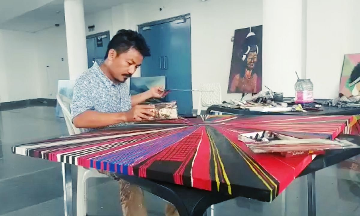This Naga artist's 'shawl' is lending more colour to tribal unity