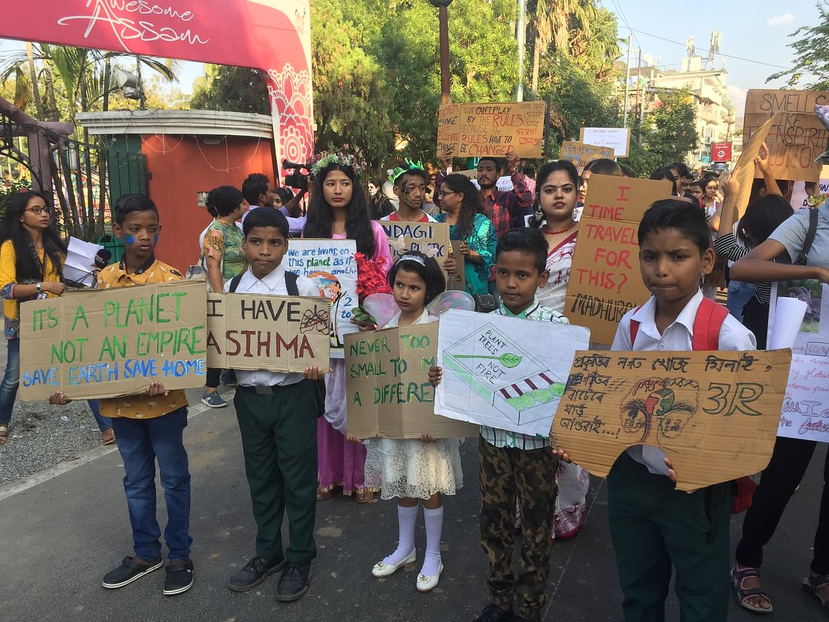 Children holding placards to participate in 'Fridays For Future' movement in Guwahati, Assam