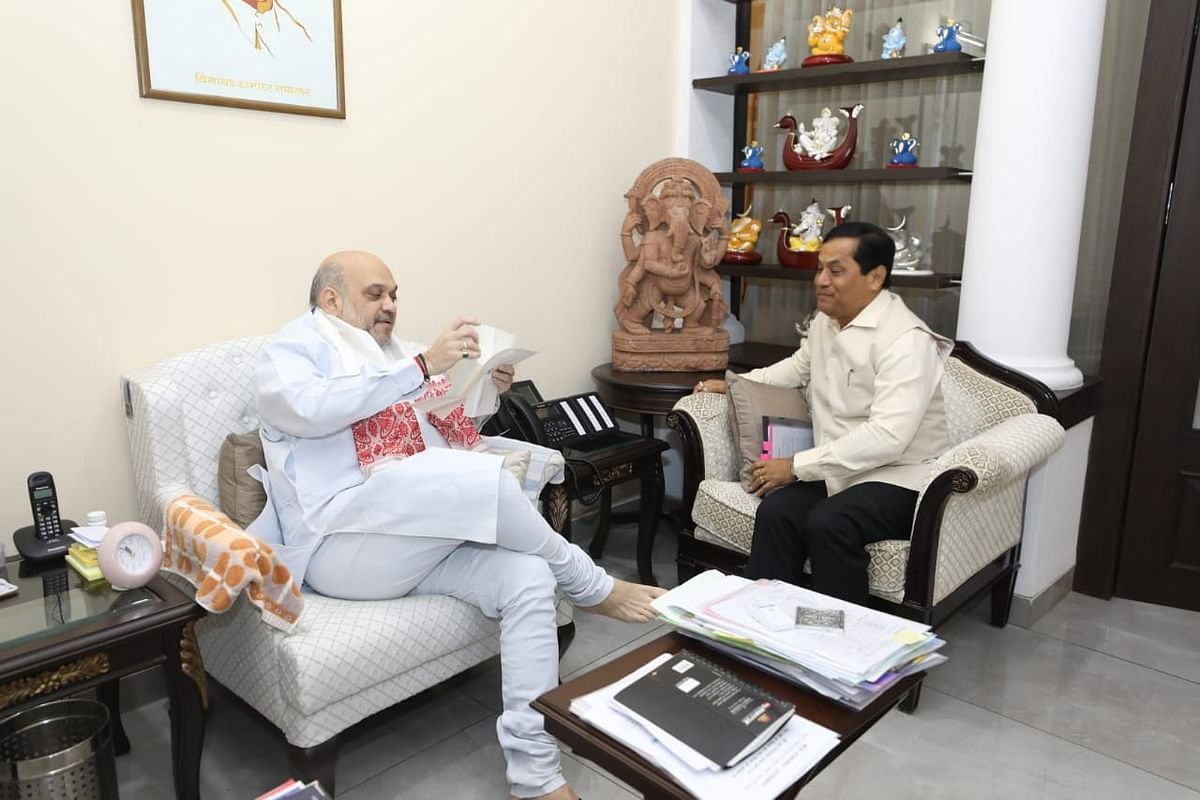 Assam CM Sarbananda Sonowal (right) interacting with Union home minister Amit Shah in New Delhi