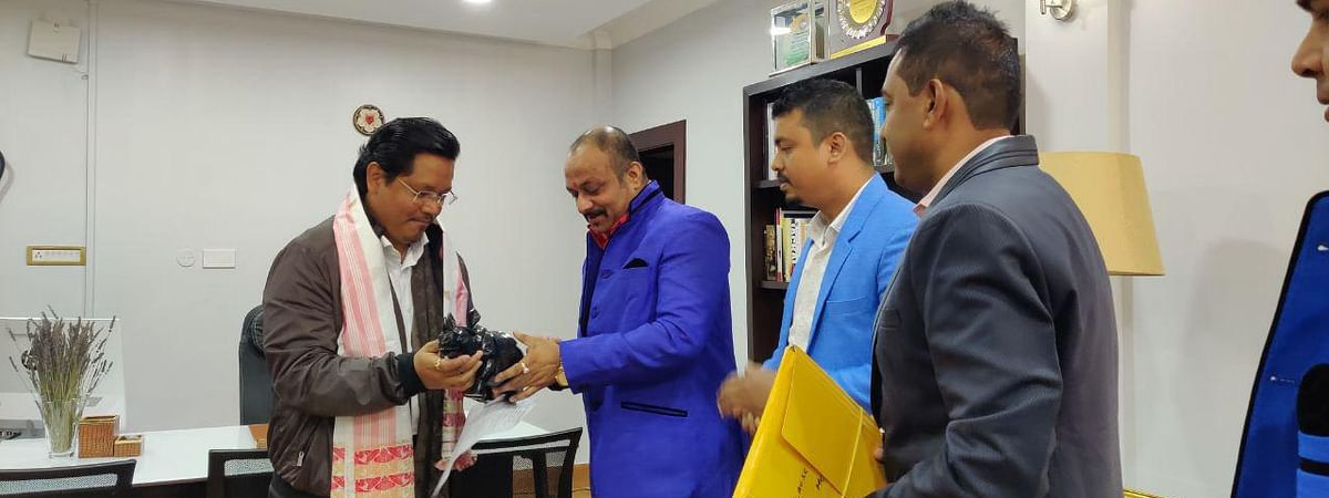 President of APW, Aabhijeet Sharma, handing over a memento to Meghalaya chief minister Conrad Sangma in Shillong on Friday morning