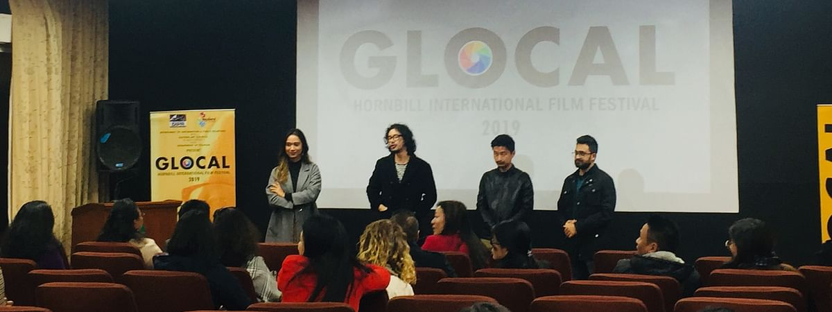 Director Nicholas Kharkongor, along with some of the crew members of 'Axone' at the Glocal Hornbill International Film Festival in Kohima, Nagaland