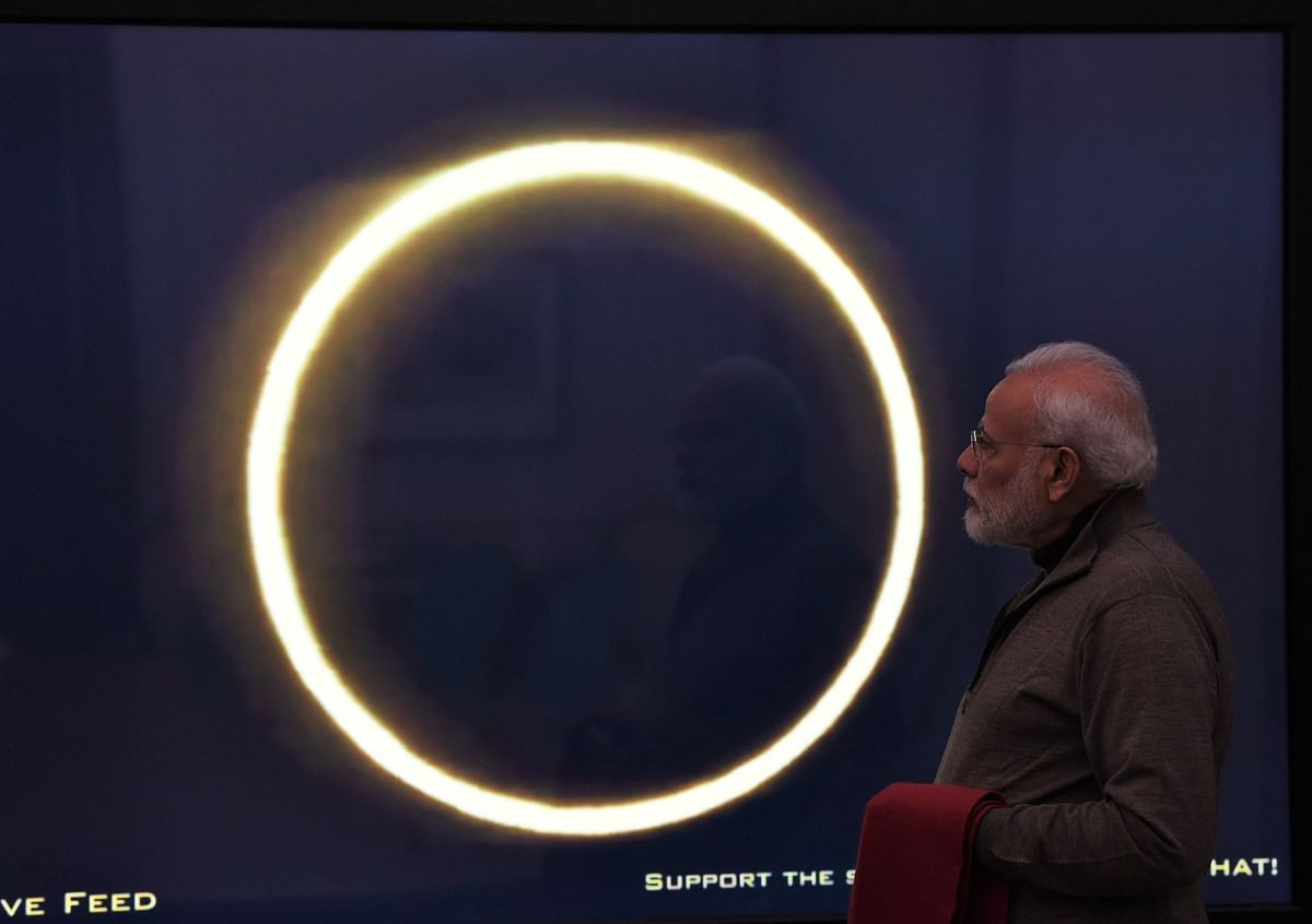 Prime Minister Narendra Modi trying to watch the solar eclipse