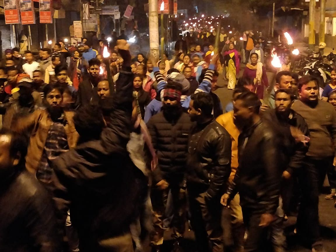 Thousands of residents took out a torch procession from Dihingia village to Thana Charali in Assam's Tinsukia town on Tuesday evening