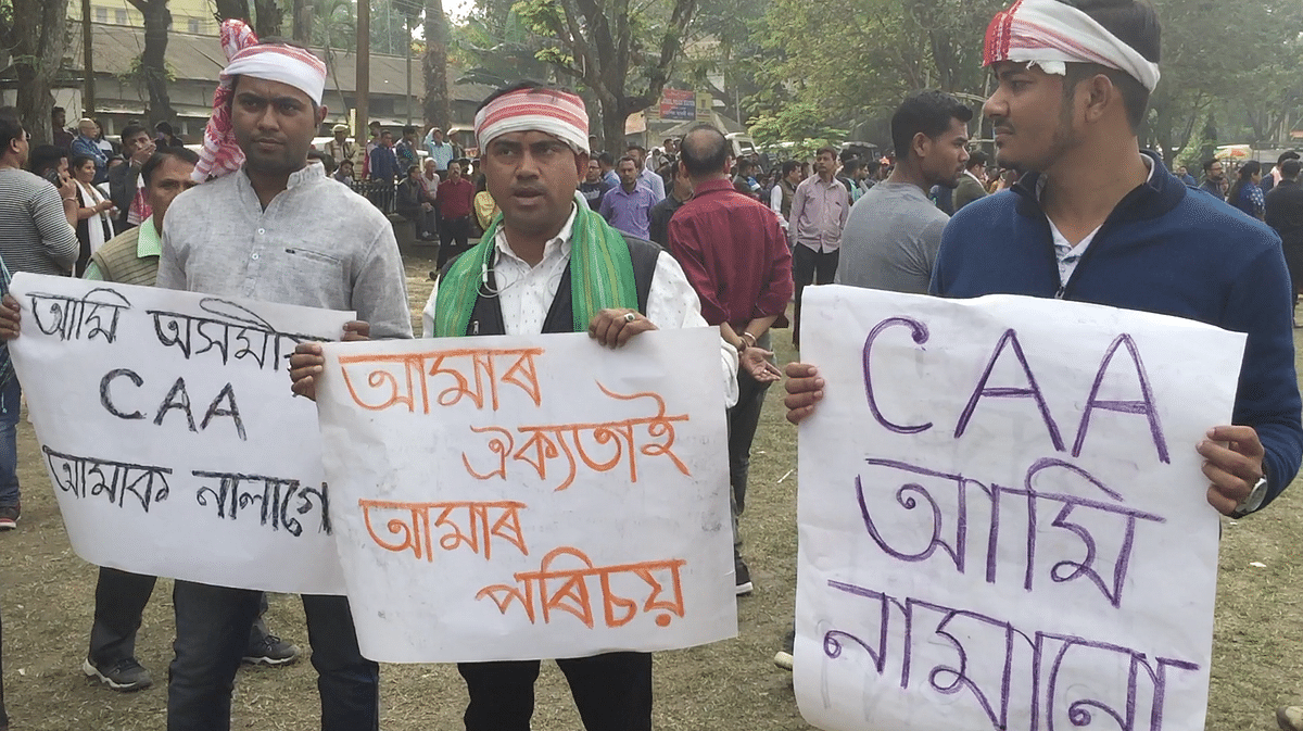 The woman stood in the middle of the crucial GS Road in front of the state secretariat in Guwahati while protesters and security personnel clashed