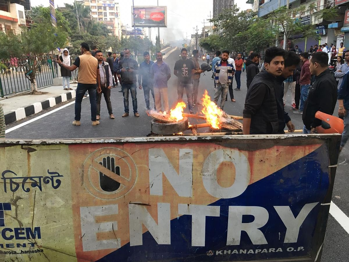 Anti-CAB protesters burning tyres on GS Road, the lifeline of the city