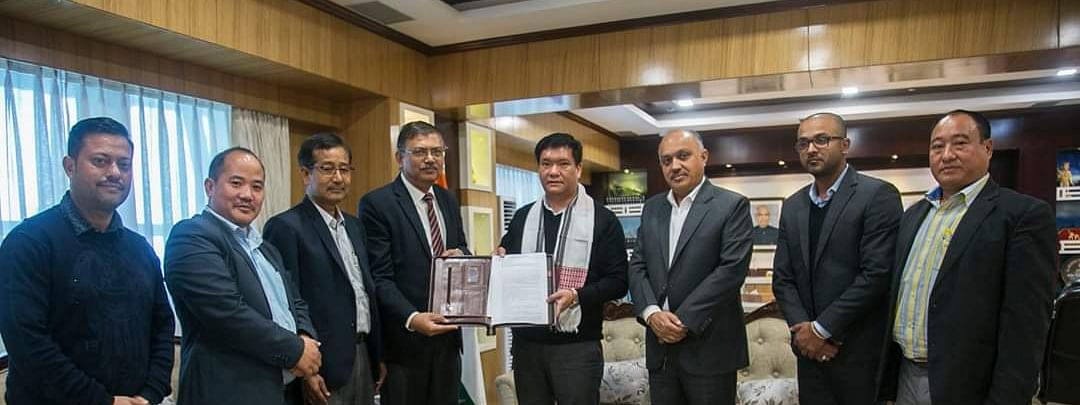 Arunachal Pradesh chief minister Pema Khandu handing over the licences to OIL chief general manager (FB) Inderjit Baruah and his team in Itanagar on Wednesday